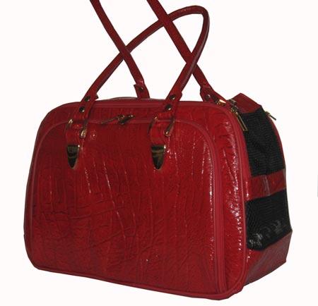 Сумка имеет 2 кармана.  Окошко открывается, внутри сумки имеется карабин...
